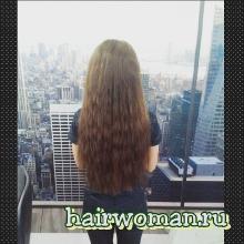 Нарощены кудрявые волосы